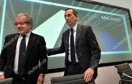 Roberto Maroni (L), President of nothern Italy's Lombardy region, and Milan's MAyor Giusepppe Sala (R)  leave a press conference on the occasion of the draw for the host city for European Medicines Agency (EMA), in Milan, Italy, 20 November 2017. The EU decided to relocate the European Medicines Agency (EMA) to Amsterdam, not Milan by drawing the name from a hat in Brussels after Milan and Amsterdam were awarded the same amount of votes. The EMA needs to be relocated from London as the United Kingdom chose to trigger Article 50 and leave the EU, dubbed Brexit'.