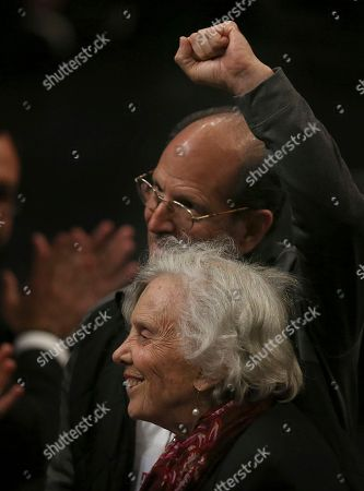 Migrant Rights Activist Father Alejandro Solalinde, top, and Mexican author Elena Poniatowska, are singled out by Presidential hopeful Andres Manuel Lopez Obrador at a rally in the National Auditorium in Mexico City, . Lopez Obrador, making his third bid for Mexico's presidency, laid out his platform for next year's presidential elections