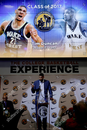 Stock Photo of Wake Forest's Tim Duncan speaks to the media during a news conference, in Kansas City, Mo. Duncan was one of eight people inducted into the National Collegiate Basketball Hall of Fame Sunday