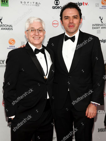 Roberto Rios, Fernando Rovzar. Roberto Rios, left, and Fernando Rovzar, right, attend the 45th International Emmy Awards