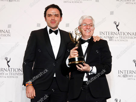 "Stock Image of Fernando Rovzar, Roberto Rios. Fernando Rovzar, left, and Roberto Rios, right, with the award for best non-English language U.S. primetime program for ""Sr. Avila"""