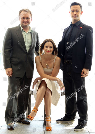 """Writer and director Rian Johnson, left, actress Emily Blunt, center, and actor Joseph Gordon-Levitt, from the upcoming film """"Looper"""", pose for a portrait during Comic-Con, in San Diego"""