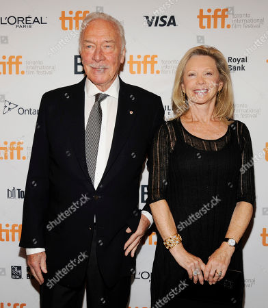 """Christopher Plummer, a cast member in """"Hector and the Search for Happiness,"""" poses with his wife Elaine Taylor at the premiere of the film at the Winter Garden Theatre during the 2014 Toronto International Film Festival, in Toronto"""