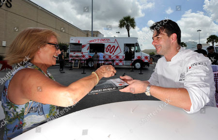 Chef Johnny Iuzzini signs autographs of his book at the Macy's Memorial City location in Houston, on . Iuzzinni hits the road with the Macy's Food Truck as part of the American Icons campaign