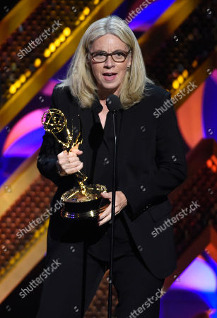 """Mary Connelly from """"The Ellen DeGeneres Show"""" accepts the award for outstanding entertainment talk show at the 42nd annual Daytime Emmy Awards at Warner Bros. Studios, in Burbank, Calif"""