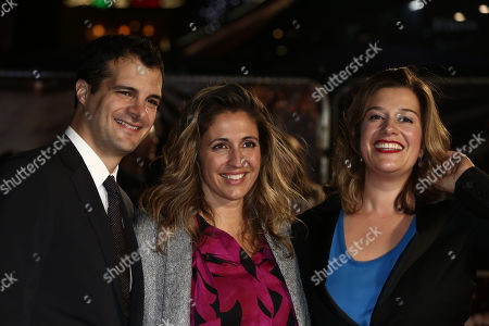 Producers, from left, Pouya Shahbazian, Melissa hook, and Alice Weinberg, pose for photographers on arrival at the premiere of the film 'American Honey', showing as part of the London Film Festival in London