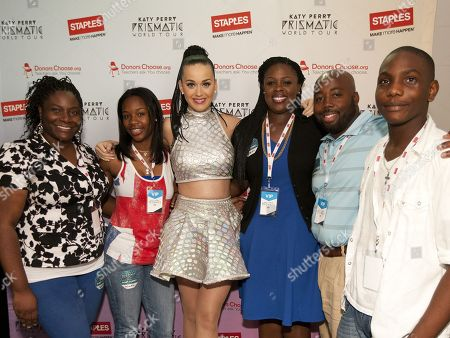 Global pop star Katy Perry, center, with Bunche Middle School staff, students and family, left to right, Shicara Barber, Jazmine White, Eshe Collins, Matthew Hall and Jaylin Barber, backstage at the Philips Arena during her Prismatic World Tour performance, in Atlanta, Georgia. As part of its $1 million dollar donation to online charity DonorsChoose.org, Staples announced it has fully-funded the balance of every project on DonorsChoose.org in the Atlanta, GA community. This $128,158 donation helped 77 teachers fulfill classroom needs and helped more than 8,779 students in the Atlanta public school district. Katy Perry teamed up with Staples and DonorsChoose.org to �Make Roar Happen� and support teachers during this back-to-school season