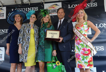 Charles Villoz, second right, and Jennifer Judkins, left, both of Longines, present Lacey Johansson, center, of Federal Hill, MD, with a Longines Conquest Classic diamond timepiece after she won the Longines Most Elegant Woman at the Preakness contest, in Baltimore, MD. as judges Brianna Mott, second left, and Ms. Racing Queen Linsey Toole look on. Longines, the Swiss watch manufacturer known for its luxury timepieces, is the Official Watch and Timekeeper of the 139th annual Preakness Stakes and the Triple Crown