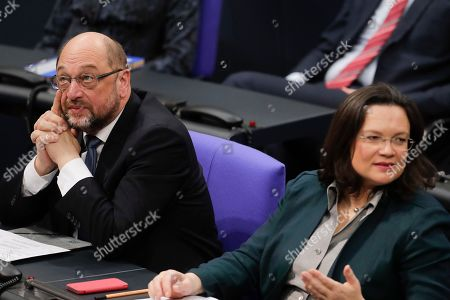 The chairman of German Social Democratic Party, SPD, Martin Schulz, left, and SPD faction leader Andreas Nahles, right, attend a plenary session of German parliament Bundestag in Berlin