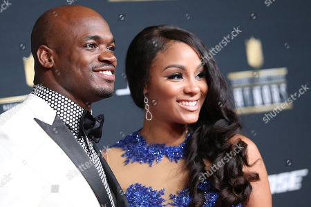 """2015 FedEx Ground Player of the Year Award winner Adrian Peterson, of the Minnesota Vikings, and Ashley Brown Peterson arrive at the """"5th Annual NFL Honors"""" at Bill Graham Civic Auditorium, in San Francisco. FedEx is the Official Delivery Service Sponsor of the NFL"""