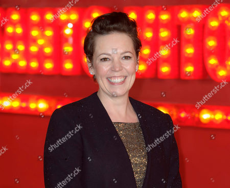 """Olivia Colman arrives for the World Premiere of """"Cuban Fury,"""" in central London. Britain has picked up a leading six International Emmy nominations, including best actor and actress nods for Stephen Dillane and Olivia Colman. Colman is being recognized for her role as a detective investigating a young boy's murder in the crime drama """"Broadchurch"""