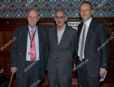 Producer David M Thompson, centre, arrives with Lord Robert Hughes, left and Paul Blomfield MP, for a reception ahead of a screening of Mandela: Long Walk To Freedom, in the Jubilee room at the House of Commons in central London