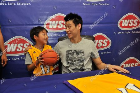 Jeremy Lin of the Los Angeles Lakers meets excited fans and signs autographs at the WSS Lincoln Heights store on