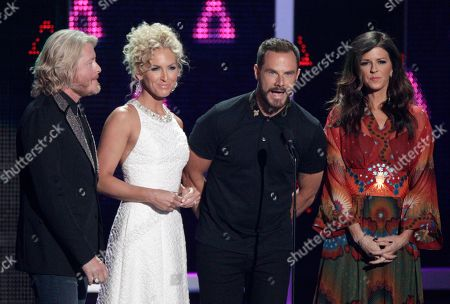 Phillip Sweet, from left, Kimberly Roads Schlapman, Jimi Westbrook and Karen Fairchild of Little Big Town presents the award for breakthrough video of the year at the CMT Music Awards at the Bridgestone Arena, in Nashville, Tenn