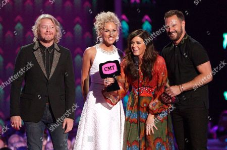 Little Big Town, from left, Phillip Sweet, Kimberly Roads Schlapman, Karen Fairchild and Jimi Westbrook accept the award for group/duo video of the year for â?oeGirl Crushâ?? at the CMT Music Awards at the Bridgestone Arena, in Nashville, Tenn