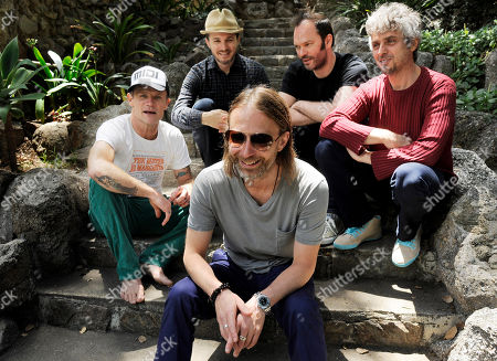Thom Yorke, front, shares a laugh with his Atoms For Peace bandmates, from left, Flea, Joey Waronker, Nigel Godrich and Mauro Refosco as they pose for a portrait on in Los Angeles
