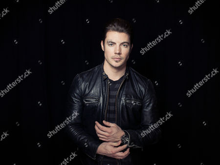 """American actor and currently starring as John Ross Ewing III in the TNT Network Series, """"Dallas,"""" Josh Henderson poses for a portrait, on in New York"""