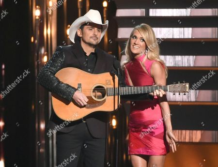 Hosts Brad Paisley, left, and Carrie Underwood speak at the 49th annual CMA Awards in Nashville, Tenn. Paisley and Underwood, along with Dierks Bentley, Eric Church, Maren Morris and Keith Urban will perform at the 50th annual Country Music Association Awards show on Nov. 2