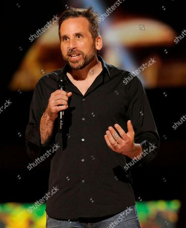 """Ken Levine, creative director and co-founder of Irrational Games, presents the world premiere of """"BioShock Infinite"""" on stage at Spike's 10th Annual Video Game Awards at Sony Studios, in Culver City, Calif. Levine is hoping the companion character, Elizabeth, provides a new depth to """"Infinite,"""" one that wasn't reached in the original """"BioShock,"""" whose voiceless protagonist didn't have a sidekick. It's been a daring and daunting endeavor for the game's makers, especially considering Elizabeth was originally envisioned as a completely mute and scripted character"""