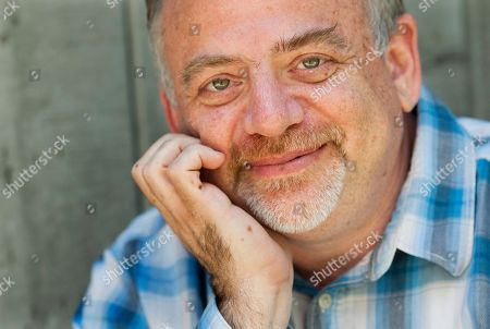 """Composer Marc Shaiman poses at his home in Los Angeles. Shaiman and partner Scott Wittman are nominated for an Emmy for their song, """"Hang the Moon,"""" from TV's """"Smash."""" Their latest stage musical, """"Charlie and the Chocolate Factory,"""" is a hit on London's West End"""