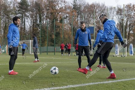 (L-R) Basel's Omar Gaber, Kevin Bua and Mohamed Elyounoussi attend a training session in Basel, Switzerland, 21 November 2017. FC Basel 1893 play Manchester United on 22 Novemver 2017 in an UEFA Champions League group stage match.