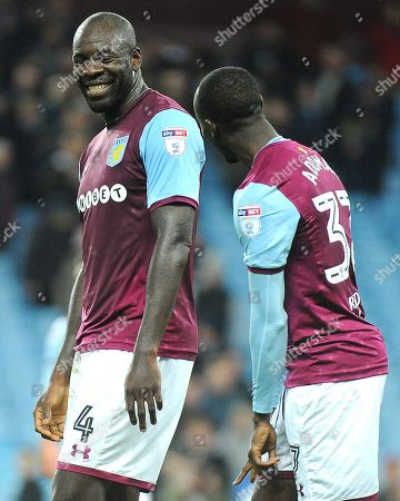 Stock Photo of Christopher Samba of Aston Villa smiles at the full time whistle