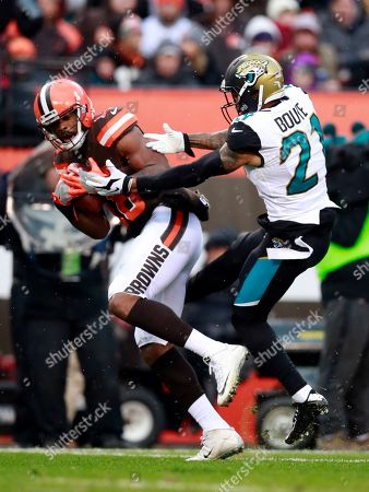 Kenny Britt, Jamar Taylor. Cleveland Browns wide receiver Kenny Britt (18) catches a pass in front of Cleveland Browns cornerback Jamar Taylor (21) during an NFL football game, in Cleveland
