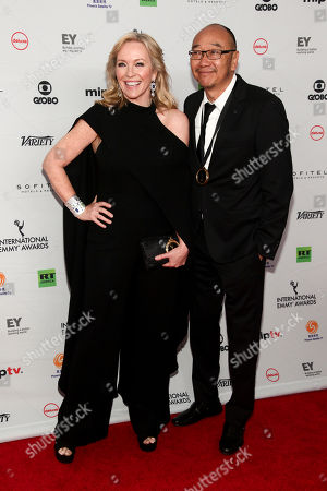 Stock Picture of Rebecca Gibney, Tony Ayres. Rebecca Gibney, left, and Tony Ayres, right, attends the 45th International Emmy Awards at the New York Hilton, in New York