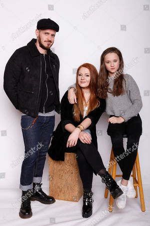 """From left, director Martin Owen, actresses Elizabeth Morris, and Isabelle Allen pose for a portrait to promote the film, """"Let's Be Evil"""", at the Toyota Mirai Music Lodge during the Sundance Film Festival on in Park City, Utah"""