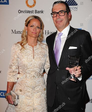 """Stock Photo of Heather Mnuchin, left, and Steven Mnuchin arrive at The Kaleidoscope Ball's """"Designing The Future"""" at the Beverly Hills Hotel in Beverly Hills, Calif. Trump, the presumptive Republican presidential nominee, recently hired a national finance chairman, scheduled his first fundraiser and is on the cusp of signing a deal with the Republican Party that would enable him to solicit donations of more than $300,000 apiece from supporters. To help raise the needed funds, he tapped Steven Mnuchin, a New York investor with ties in Hollywood and Las Vegas, but no previous political fundraising experience"""