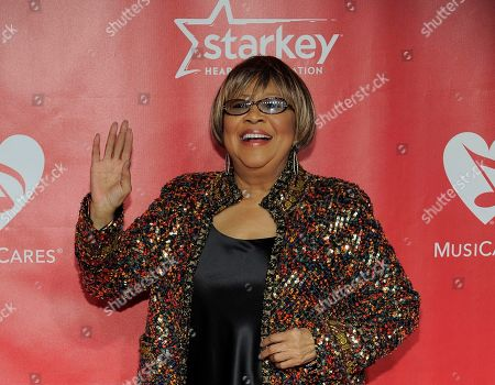 """Mavis Staples arrives at the MusiCares Person of the Year tribute honoring Bruce Springsteen at the Los Angeles Convention Center in Los Angeles. An all-star lineup of musicians including Gregg Allman, Aaron Neville, Taj Mahal, Eric Church, Michael McDonald, Patty Griffin and more will salute Staples during the """"I'll Take You There - Celebrating 75 Years of Mavis Staples"""" event on Nov. 19, 2014, in Chicago"""