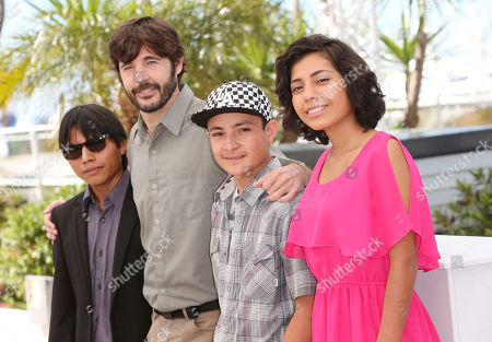 The Golden Cage cast members, from left, actor Rodolfo Dominguez, director Diego Quemada-Diez, actor Brandon Lopez and actress Karen Martinez, pose for photographers during a photo call for the film at the 66th international film festival, in Cannes, southern France. The Golden Cage received 14 Ariel award nominations, that include best film, best direction and best original script, announced in Mexico City