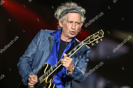 Stock Image of Keith Richards performs at The Rolling Stones Zip Code Tour opening night at Petco Park in San Diego. Richards doesn't keep a list of the Top 10 Rolling Stones albums. But he's happy to place Sticky Fingers, now being re-released in a deluxe edition, near the very top. The album catches the Stones in transition, with Mick Taylor stepping fully into his role as the late Brian Jones' replacement. The Stones also moved beyond their comfort zone, recording several songs at the famed Muscle Shoals Sound Studio in rural Alabama rather than in their usual London haunts