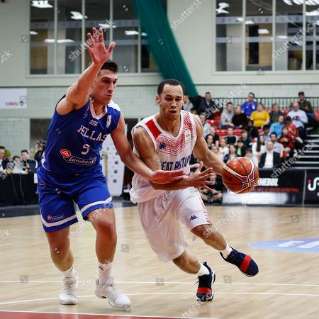 Great Britain Guard, Andrew Lawrence (4) drives to the basket with Greece's Giannis Bouroussis defending
