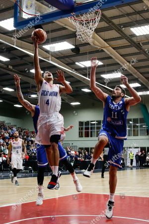 Great Britain Guard, Andrew Lawrence (4) scores with Greece's Vangelis Margaritis contesting