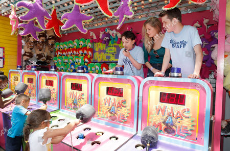 """IMAGE DISTRIBUTED FOR FOX SEARCHLIGHT - River Alexander, Zoe Levin and Liam James host a Wack-A-Mole game for """"The Way Way Back"""" First Day of Summer Kick Off, on Friday, June, 21, 2013 in Santa Monica, California"""