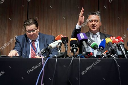 Dragan Ivetic, lawyer for former Bosnian Serb military chief Ratko Mladic, and Darko Mladic (Son) gestures, during a press conference after the Yugoslav War Crimes Tribunal, ICTY, handed down its verdicts in Mladic's genocide trial in The Hague, Netherlands, . A lawyer says that Bosnian Serb army commander Ratko Mladic will appeal his genocide convictions at the U.N. war crimes court for the former Yugoslavia