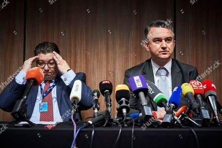 Stock Image of Dragan Ivetic, lawyer for former Bosnian Serb military chief Ratko Mladic, left, sits with his son Darko Mladic during a press conference after the Yugoslav War Crimes Tribunal, ICTY, handed down its verdicts in Mladic's genocide trial, in The Hague, Netherlands, . A lawyer says that Bosnian Serb army commander Ratko Mladic will appeal his genocide convictions at the U.N. war crimes court for the former Yugoslavia