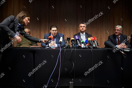 Dragan Ivetic, lawyer for former Bosnian Serb military chief Ratko Mladic, centre left and Darko Mladic, centre right, sit during a press conference after the Yugoslav War Crimes Tribunal, ICTY, handed down its verdicts in Mladic's genocide trial in The Hague, Netherlands, . A lawyer says that Bosnian Serb army commander Ratko Mladic will appeal his genocide convictions at the U.N. war crimes court for the former Yugoslavia