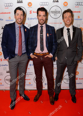 Drew Scott, and from left, Jonathan Silver Scott, and J.D. Scott arrive at the Producers Ball at the Royal Ontario Museum, in Toronto
