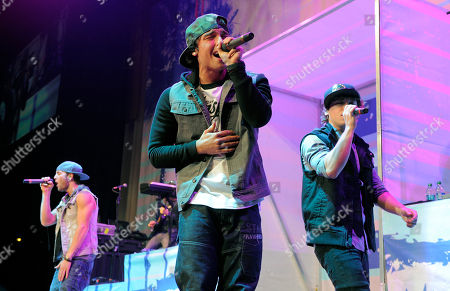 Drew Chadwick, left, Wesley Stromberg, center, and Keaton Stromberg of Emblem3 perform in concert at the Staples Center on in Los Angeles