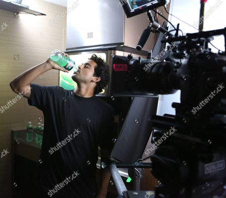 IMAGE DISTRIBUTED FOR MOUNTAIN DEW - Professional skateboarder Paul 'P-Rod' Rodriguez drinks a bottle of Mtn Dew Baja Blast while filming the Mtn Dew Baja Blast 'Baja Breakout' video, on Thurs., in Los Angeles. Rodriguez appears in the short film, debuting today, Tues., May 6, 2014, along with racing champion Dale Earnhart Jr. and professional snowboarder Danny Davis. Mountain Dew recently announced that, for the first time, Mtn Dew Baja Blast - which was introduced 10 years ago as a 'Taco Bell® Original' - will also be available for a limited time in bottles and cans. The tropical lime flavored beverage started hitting shelves on Mon., May 5, 2014