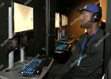 "Stock Image of Professional basketball player Roy Hibbert plays ""Tom Clancy's Rainbow Six Siege"" at the Ubisoft booth at E3, at the Los Angeles Convention Center"