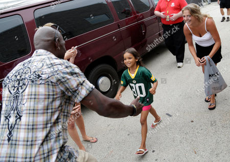 A young girl is treated like a VIP when former Green Bay Packer, Donald Driver surprises her backstage on behalf of U.S. Cellular at Summerfest, in Milwaukee, Wis