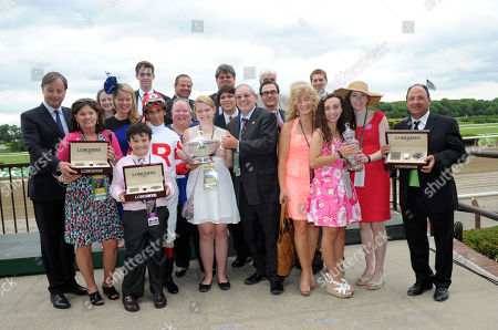 Charles Villoz, left, and Jennifer Judkins, third left, both of Longines, award jockey John Velazquez, owner Kenneth Ramsey and trainer Wayne Catalano with watches from the Longines Saint Imier collection after their horse Stephanie's Kitten won the $500,000 Longines Just A Game Stakes, at Belmont Park in Elmont, NY. Longines, the Swiss watchmaker known for its elegant timepieces, is the Official Watch and Timekeeper of the 145th running of the Belmont Stakes