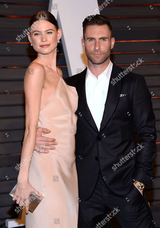 "Adam Levine, right, and Behati Prinsloo arrive at the 2015 Vanity Fair Oscar Party in Beverly Hills, Calif. A spokeswoman for ""The Voice"" coach says Levine and the Victoria's Secret model welcomed a daughter named Dusty Rose Levine. No other details were provided. The frontman for the band Maroon 5 and Prinsloo have been married since 2014"