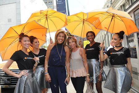 Hoda Kotb and Jennifer Miller are shaded from the hot summer sun by AccuWeather's MinuteCast umbrellas at New York Fashion Week, in New York. The AccuWeather MinuteCast Street Team is at it again helping Fashion Week attendees stay stylish and one-step ahead of any possible precipitation