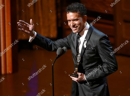 Tony Award recipient Brian Stokes Mitchell waves to the audience at the Tony Awards at the Beacon Theatre, in New York. Stokes Mitchell will lead a concert of the sprawling musical Ragtime, about the clash of cultures that created America, in Ellis Island, the gateway for millions of immigrants. The one-night-only show on Aug. 8, 2016 will also feature performances by Olivier Award-winner Laura Michelle Kelly and two-time Tony Award nominee Brandon Victor Dixon