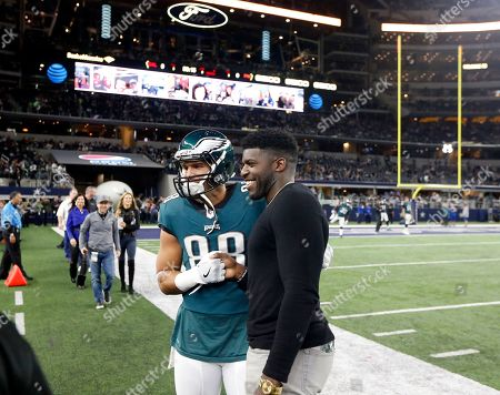 With former Eagles linebacker Emmanuel Acho prior to an NFL football game against the Dallas Cowboys, in Arlington, Texas