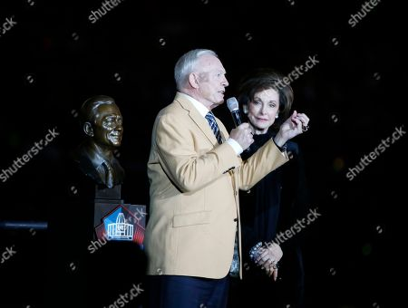 Dallas Cowboys owner Jerry Jones speaks during his Hall of Fame ring presentation as his wife Gene Jones listens, during his halftime of an NFL football game, in Arlington, Texas